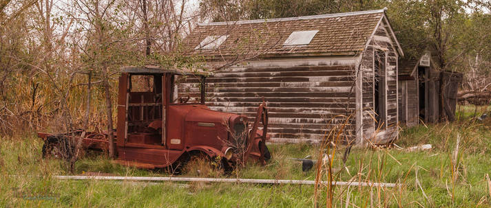 An old, rusted Ford truck